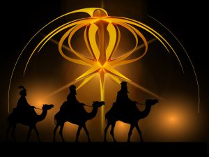 An image of 3 men on camels with golden light around them.